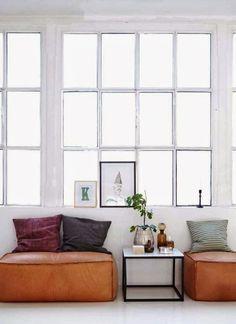 White warehouse windows and burnt orange furnishings