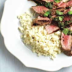 Paired with our grilled steak with spicy cilantro sauce, this cauliflower rice recipe is a healthy light side. Rice Recipes, Side Dish Recipes, Vegetable Recipes, Meat Recipes, Fall Recipes, Food Processor Recipes, Vegetarian Recipes, Cooking Recipes, Healthy Recipes
