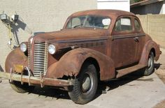 The 1938 Buick was said to be the first American production car to go over 100 MPH. This rusty old Buick is listed on craigslist. Vintage Trucks, Old Trucks, Old American Cars, Man Cave Room, Buick Cars, Go Car, Rusty Cars, Abandoned Cars, Barn Finds