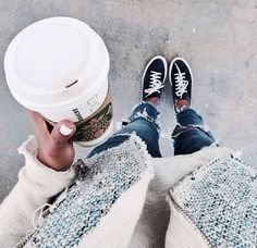 Love the tweed jacket and ripped jeans.