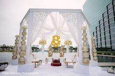 White outdoor draped mandap. http://www.maharaniweddings.com/gallery/photo/88970
