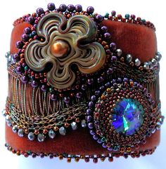 Wired for Embroidery - Sherry Serafini How to manipulate and use a variety of elements in bead embroidery, including WireKnitZ wire, velvet ribbon, felt suede, a handmade glass flower, wooden donuts, and a rivoli.