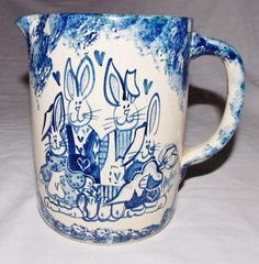 COBALT DECORATED SALT GLAZE STONEWARE PITCHER BY MARTHA FEATURING THE WHOLE RABBIT FAMILY FROM 1988