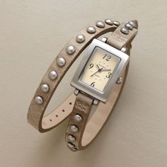 THEN AND NOW WATCH -- Vintage effects come face to face with up-to-the-minute, double-wrap styling. Studs are antiqued