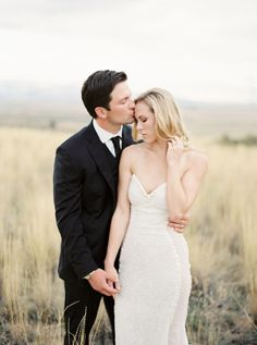 Photography: Rebecca Hollis Photography - rebeccahollis.com Wedding Dress: Galia Lahav - www.galialahav.com   Read More on SMP: http://www.stylemepretty.com/2016/03/04/classic-romantic-backyard-wedding-in-montana/