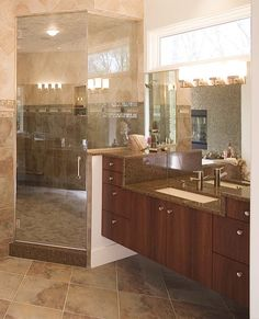 Choose the Style of #Vanity. Once you find the layout that best suits your #bathroom and determine how many sinks you want the next step is to decide on the vanity design. Do you prefer traditional cabinets? An antique furniture piece? A pedestal sink? #floatingvanity #undermountsink #customcabinetry #Teak #slate #contemporarybath #steamshower #glasstile #Brizofaucets #Cambria #MartinBrothers #thefinesthomesanywhere #bathdesign by martin.brothers