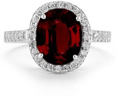 ApplesofGold.com - Garnet and Diamond Cocktail Ring in 14K White Gold, $725!  his Garnet and Diamond Cocktail Ring in 14K White Gold is undeniably glamorous. This piece's combination of rich red glimmer and colorless dazzle (in the form of 0.34 carats of diamonds) is instantly attention-grabbing, and its enduring beauty will allow it to turn heads and catch eyes for many years to come.