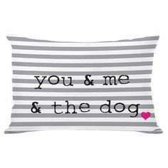 """Polka dot throw pillow in grey with a typographic design. Made in the USA.  Product: PillowConstruction Material: Premium polyester cover and polyester down alternative fillColor: Gray, black, white and pinkFeatures: Insert included Zipper closure and removable coverMade in the USADouble sided printing Dimensions: 14"""" x 20""""Cleaning and Care: Removable cover is machine washable"""
