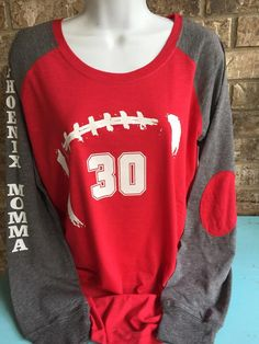 Football Mom Shirt with # on front, Football mom shirts, RUNS SMALL, customized with # Football Signs, Football Mom Shirts, Football Players, Bow Back Shirt, Sports Mom, Cool T Shirts, Girlfriends, Georgia, Vinyl Crafts
