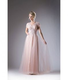 You will look like a graceful modest princess in our blush pink chiffon prom dress! This simple design features a short sleeve bodice with a subtle v-neckline. Embroidered lace appliques garnish this sheer top and features silver stones that glisten as yo
