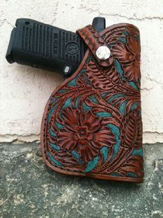 Tooled leather holster created by Clayton Powell of Bucking Pony Leathers in Bandera,TX