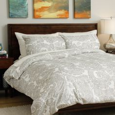Outfit you bedroom in the trendy tribal-inspired style of this gorgeous paisley-print duvet cover set. The 100-percent cotton construction sports a white background with grey print trimmed with a slightly shimmery silvertone.