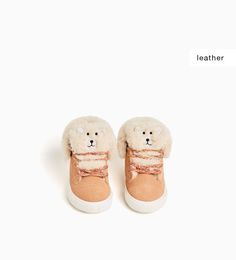 LEATHER HIGH-TOP SNEAKERS WITH A BEAR DETAIL