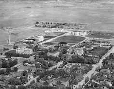 Aerial view of the University of Wyoming campus in 1931. Half Acre Gym (16) is the large building located on the very edge of campus at the top of the shot, just to the left of the stadium and athletic fields (17) where the student union now stands. (Wyoming State Archives BCR state government buildings survey photo album)