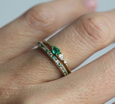 Pretty little cluster ring with emerald, diamonds. Stones can be also reset in yellow or white gold metal. Same design can be made also with other custom gemstones per request. Our diamonds listed are all-natural with absolutely no enhancements or treatments. Diamonds are conflict-free. We