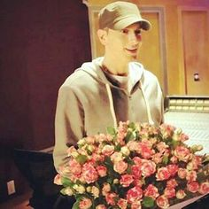 Eminem smiling! Two of my most favorite things-Eminem and roses!