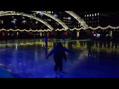Ice Skating at Nathan Phillips Square at night