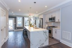 Contemporary Kitchen with High ceiling, Subway Tile, Kitchen island, Flush, Ulani Mini Pendant, One-wall, Chandelier