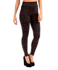 Soft as can be, these leggings are ideal for any chic closet creation. Their stretch design hugs curves in comfort, while the snowflake pattern promises to fashion a versatile pair.