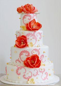 wedding cake with pink swirls