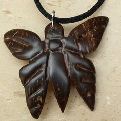 Hand carved coconut shell butterfly #butterfly…