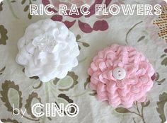 ric rac flower tutorial. http://www.craftinessisnotoptional.com/2011/06/ric-rac-flower-tutorial.html