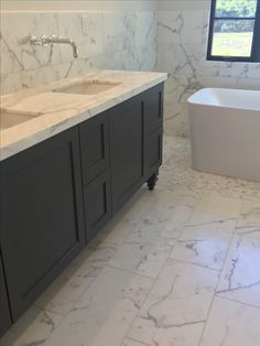 Keeping Interiors Calacatta marble and mini calacatta herringbone