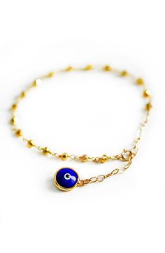 Brush off any negative energy with our royal blue enamel evil eye bracelet Its the perfect way to add a touch of gold to your outfit with a little