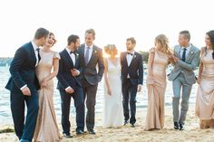 With a focus on soft hues of champagne,sparkly gold,grey this styled shoot is a romantic seaside affair. Roz la Kelin wedding dress,sparkly bridesmaid dress