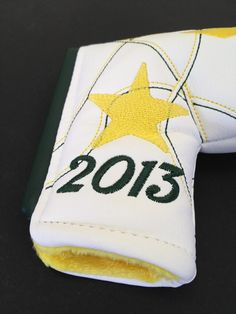 The 59 Belts company is branching out into putter covers with this green-and-gold Masters model.