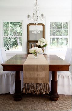 Burlap table runner with long fringe - This would a super easy and stupid cheap DIY project.