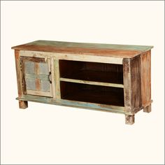 """Enjoy the rustic beauty of hand crafted simplicity with our Appalachian Wooden Window TV Console. This solid hardwood entertainment island stands off the floor on block feet. The 47"""" long and 23"""" tall media cabinet is designed with a large open 2-shelf section and a smaller closed side cabinet. The cabinet door is 4-square wooden window. This handmade television console is built with solid mango wood, a tropical hardwood grown as an eco-smart sustainable crop. <strong>Special Features…"""