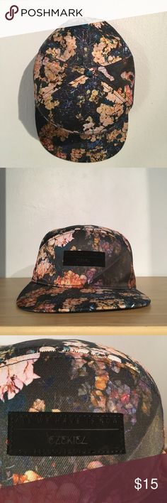 "Floral SnapBack - Ezekiel Clothing ""All We Have Is Now"" embedded in front of hat with black rectangle design. Has a slight crease on the front left side of the hat. Adjustable button sizes. 100% polyester. Brand new, never worn. No tags. Ezekiel Accessories Hats"