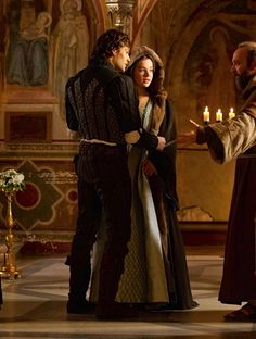 Douglas Booth as Romeo Montague and Hailee Steinfeld as Juliet Capulet inRomeo and Juliet (2013).