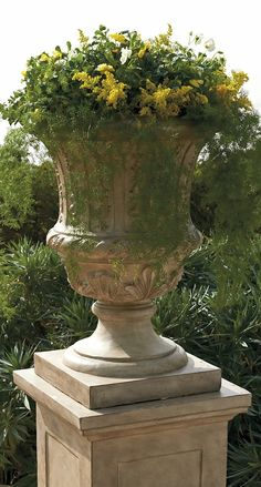 Cast from an all-weather stone and resin composite, our chateau-inspired Parisian Urn is arresting to the eye. When paired with dramatic plants, such as sculpted boxwoods, tall wispy grasses, or container-size trees, it makes a stunning addition to any entry or outdoor space.