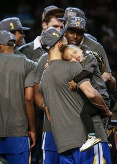 Golden State Warriors' Stephen Curry holds his daughter after Game 6 of The NBA Finals between the Golden State Warriors and Cleveland Cavaliers at The Quicken Loans Arena on Tuesday, June 16, 2015 in Cleveland, Ohio. The Golden State Warriors defeated the Cleveland Cavaliers 105 to 97 to win the NBA Finals title 4 games to 2.