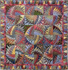 """Recycled Silk Ties: No Necks Needed Now!  56 x 56"""" by Virginia Anderson. Machine-pieced. Machine-quilted. Source-Untitled pattern by Karen Stone."""