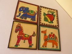 Hand painted MDF coasters with Indian folk design motifs.