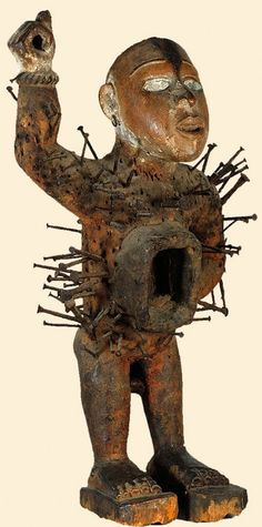 """Angola, Congo, and Democratic Republic of the Congo (Ambrizette region); Kongo (Muserongo) peoples Nkisi Nkonde (power figure) Wood, iron nails, glass, resin H. 51.4 cm (20"""") The University of Iowa Museum of Art, The Stanley Collection, X1986.573 Certainly the most dramatic of the magical figures produced across the Southern Savannah are the nkisi nkonde (pl. minkinsi minkonde) figures that are usually called """"nail fetishes"""" in the popular literature on African art. Most frequently,"""