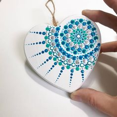This hand painted mandala ornament is painted with acrylic paints on a wooden heart ornament approximately wide. The heart is light weight and finished with 3 coats of gloss varnish for protection. Seashell Painting, Dot Art Painting, Mandala Painting, Mandala Drawing, Stone Painting, Painted Rocks, Hand Painted, Mandala Rocks, Using Acrylic Paint