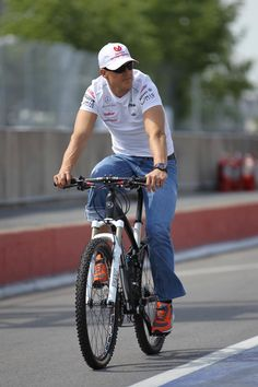 Michael Schumacher completes his first lap of the Montreal F1 circuit on his Mercedes - bicycle! 2012: XPBImages: