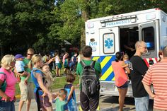 Ames residents got the chance to take a look inside police vehicles during Tuesday's National Night Out. The event, held in Bandshell Park, was a way to promote police-community partnerships and neighborhood camaraderie. Photo by Julie Ferrell/Ames Tribune   http://amestrib.com/news/national-night-out-receives-strong-community-support