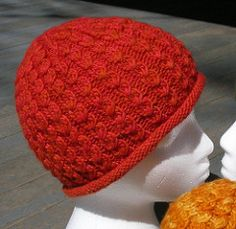 A unisex cable patterned hat in three sizes (Child's, Adult Small, and Adult Large) with two alternate brim treatments. worsted weight