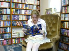 Girl  reading T. J. P. CAMPBELL's Book 2 of the BRITLAND CALLING series