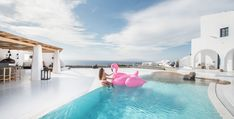 Best Boutique Hotel in Imerovigli: Sophia Suites Woman in pool with pink flamingo air mattress. Swimming Pool with an Ocean View Dana Villas Santorini, Imerovigli Santorini, Santorini Hotels, Santorini Greece, Skopelos Greece, Best Boutique Hotels, Luxury Lifestyle Women, Beautiful Hotels, Pool Houses