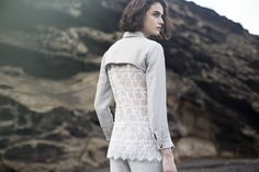 Back of NEVA shirt is full of embroidery to contrast with the simple front of the shirt