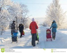 Mstyora,Russia-January 24,2013: Young mas and small children on walk at winter solar day in Russia