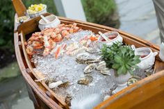 The boat of crushed ice and the fresh delicious seafood from the cold waters of Atlantic—succulent shrimp, lobster and oysters epitomized th...