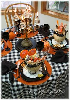 What a fun table!  And a great way to give a little candy to the kids too old for trick or treating.  Gonna see if I can make my table look like this.  So festive.