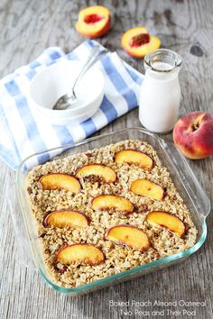 Baked Peach Almond Oatmeal on twopeasandtheirpod.com #recipe - this did not turn out as great as I'd hoped - the oats seemed to soak up the liquid before being fully cooked.